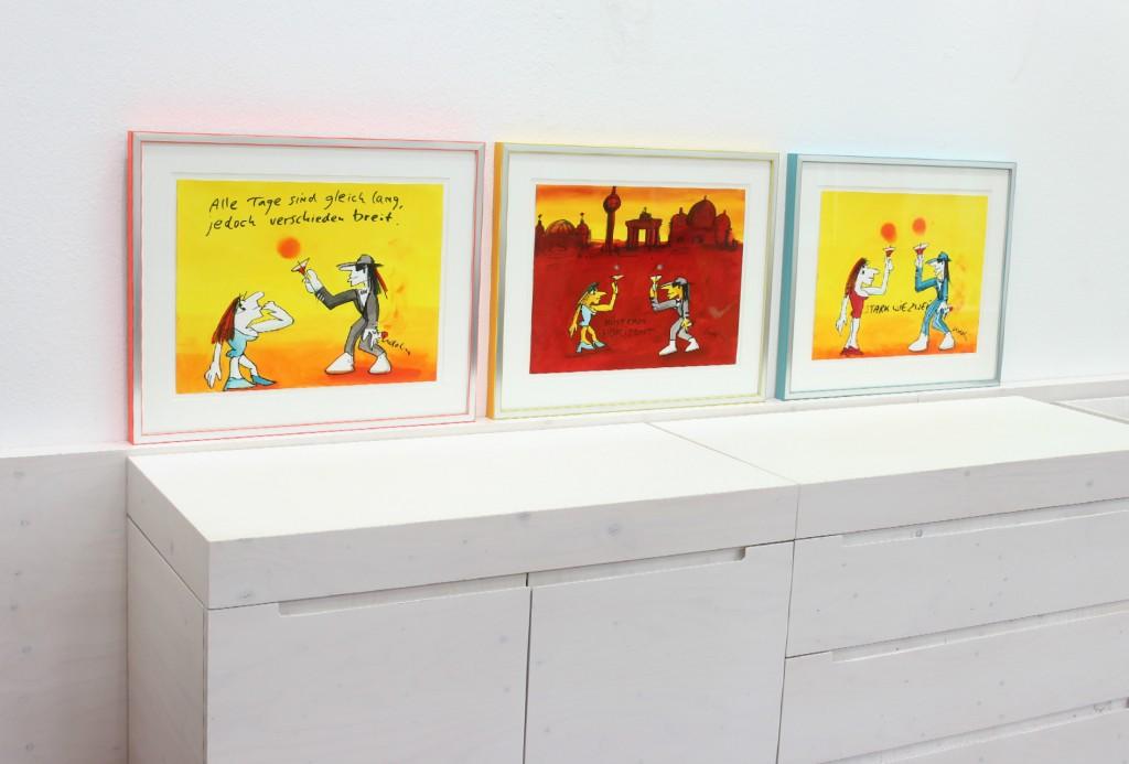 Drei Mischtechniken von Udo Lindenberg jeweils farblich passend gerahmt